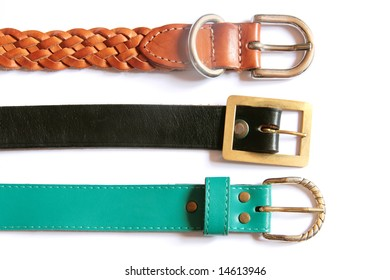 Three different belts with metal buckles isolated on white background