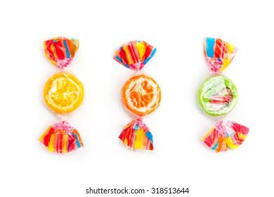 three different candies on white