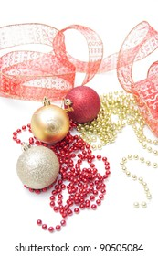 Three different christmas balls with red and gold beads and ribbon