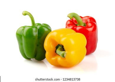 Three different colored of sweet bell peppers (capsicum) isolated on white background.
