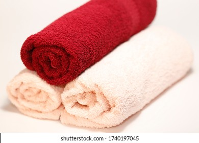 three different colored towels on a ground