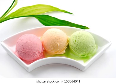 Three different colors flavors of ice cream