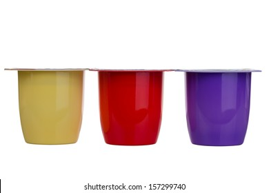 Three different colors of yogurt isolated on white background