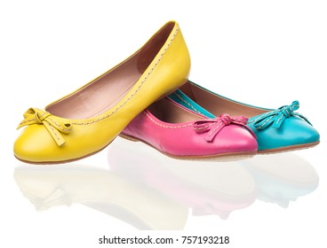 Three different female pumps over white background