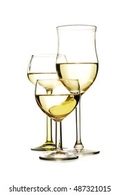 Three different glasses with white wine isolated on a white background
