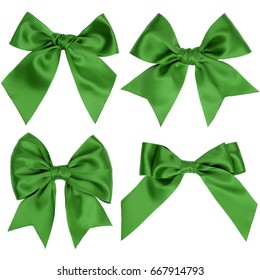 Three different green gift bows with tails on a white background