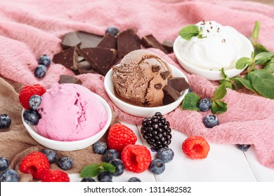 Three Different Icecream Ball Flavor Assorted Set. Various Ice Cream Dessert in Cup Side Close-up View. Brown White and Pink Gelato Color Mix. Variety Flavors Set of Soft Frozen Fruit Sorbet