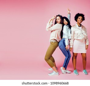 three different nation girls with diversuty in skin, hair. Asian