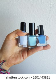 Three different shades of blue nail polish