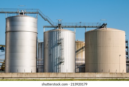 Three different size silos clean construction on clear sky healthy food supply unit wide angle, clean master shot.