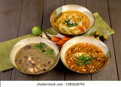 Three different soups: chicken with pasta, hodgepodge, tom-yam