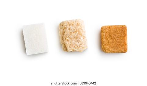 three different sugar cubes on white background