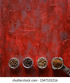 Three different varieties of coffee beans light medium dark and ground coffee on old vintage red background with copy space. Top view. Banner. Minimalism.