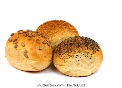 Three different wheat buns, white background