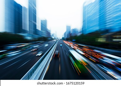 Three dimensional traffic roads and bridges show a very beautiful curve at night. - Shutterstock ID 1675120159