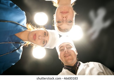 three doctor on operations with white lamp