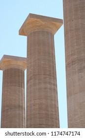 Three Doric columns.