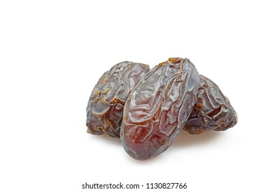 Three dried dates isolated on white