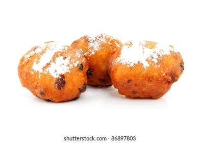 Three Dutch donut also known as oliebollen, traditional New Year's eve food isolated on white background