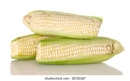 Three ears of fresh white corn on the cob