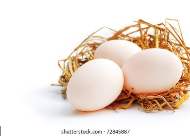 Three eggs on the net, white background isolated