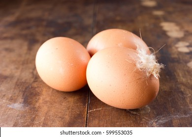 Three eggs on wooden background