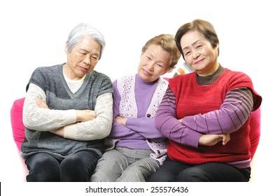 Three elderly women of that pondering