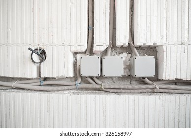 Three electrical junction boxes with plastic conduit pipe connection