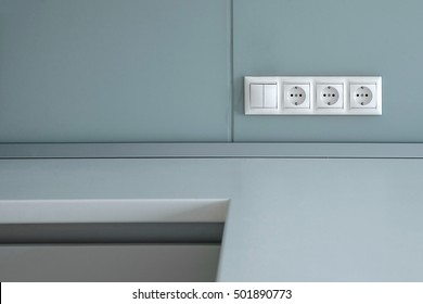 three electrical sockets with a switch on the wall