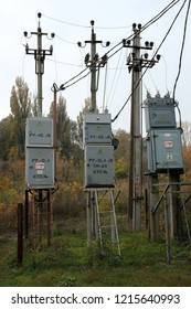 "Three electrical transformers with a danger sign. Translation: ""KTP - Complete transformer substation. RU - Switchgear. Danger - do not get in, kill!""."