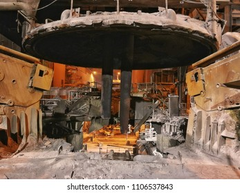The three electrodes center on the electric arc furnace roof without shell