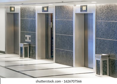 Three elevator doors in office building. Wide angle view of modern elevators with doors. Elevators in the modern lobby house or hotel.