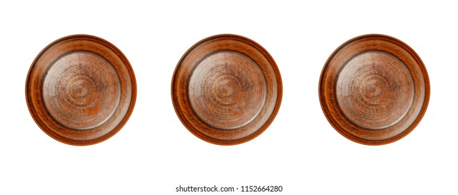 Three empty clay plates isolated on white background. Ancient clay plate on a white background
