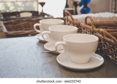 three empty coffee cups on the table
