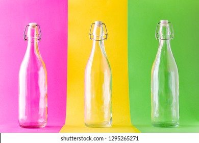 Three Empty Glass Bottles on Multicolored Background