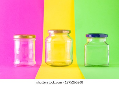 Three Empty Glass Jars on Multicolored Background