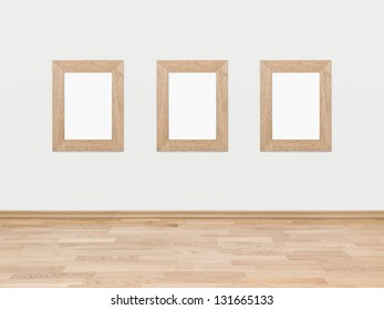 Three empty rectangular wooden frames displayed on a white wall above a hardwood wooden floor.