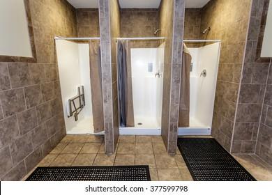 Three Empty Showers in Gym Locker Room