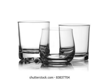 Three empty whiskey glasses