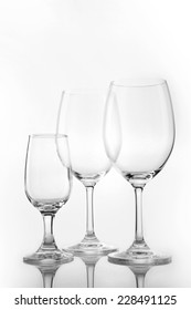 Three empty wine glasses close up with straight layout isolated white.
