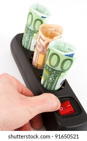 Three Euro banknotes in a black plug bar and a hand on the switch in front of a white background