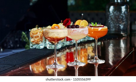 three exquisite cocktails at the bar
