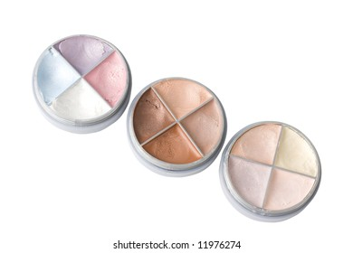 Three eye shadows isolated on white