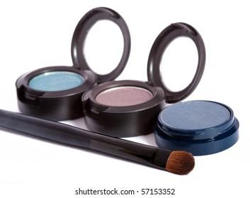 Three eyeshadows and brush