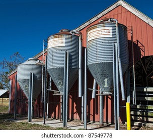 Three feeding bins on a farm