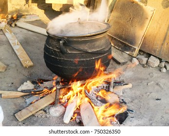Three Feet Pot on the wood fire boiling, ready for a cook to come and pour maize meal powder.