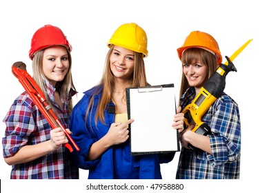 three female construction workers isolated on white background