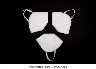 three ffp2 masks on black background. they are best best protection mask against covid-19 virus