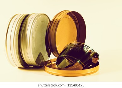 Three film tins cross processed