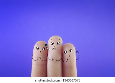 Three fingers decorated as three friends. One of them has nasogastric tube inserted.